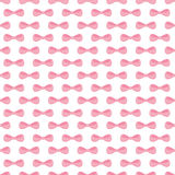 Seamless pattern with pink bows Stock Images