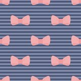 Seamless vector pattern pink bows on navy blue str. Seamless vector pattern with pastel pink bows on a navy blue strips background. For desktop wallpaper, web royalty free illustration