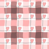 Seamless pattern in pink cage and hearts. Stock Photos