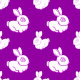 Seamless pattern pink cute rabbit with a big eye and cute short ears on a purple background, illustration for postcards, decor, po
