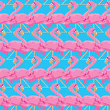 Seamless pattern with pink flamingos on blue background Royalty Free Stock Photography