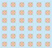 A pattern of pink flowers. A seamless pattern of pink flowers on a blue background Stock Images