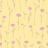 Seamless pattern with pink flowers. Yellow background with styliized roses. Royalty Free Stock Images