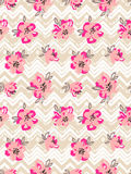 Seamless pattern with pink flowers on the zig zag background. Vector  Floral background Royalty Free Stock Images