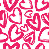 Seamless pattern of pink hearts. Seamless pattern of handdrawn brush pink hearts on white background. Hand painted vector illustration. Design for fabric Stock Photo