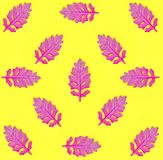 Seamless pattern with pink leaves on yellow paper background. Fashion minimal pop art style. Autumn concept. stock photography