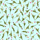Seamless pattern of pink, orange, yellow and dark red tulips painted by hand on blue background. In a chaotic manner. 10 eps Stock Photography