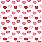 Seamless pattern with pink and red hearts Stock Image