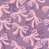Seamless pattern of pink ribbons on purple background Royalty Free Stock Photography