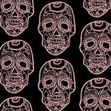 Seamless pattern with pink skulls and black background Royalty Free Stock Image