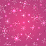 Seamless pattern with pink snowflakes royalty free stock photography