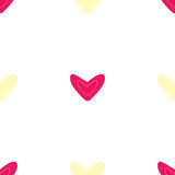 Seamless pattern with pink and yellow hearts Royalty Free Stock Image