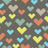 Seamless pattern with pixel hearts on a dark backg Stock Photo