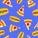 Seamless pattern with pizza and hot dog. On blue background Stock Photos