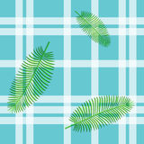 Seamless  pattern in plaid with palm leaves Royalty Free Stock Photos