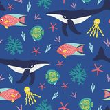 Seamless pattern of playful humback whales, happy tropical fish, octapus, and bright corals on a blue background. stock illustration