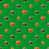 Seamless pattern with playing card suits on green background. Vector isolated illustration vector illustration