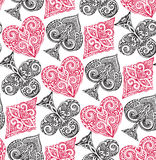 Seamless pattern with playing card suits Stock Images