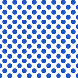 Seamless pattern with polka dots. Seamless pattern with blue polka dots on a white background. Vector Royalty Free Illustration