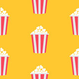 Seamless Pattern Popcorn. Cinema icon. Yellow background. Food texture. Flat design. Stock Image