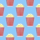 Seamless pattern with popcorn. On blue background. Vector texture Royalty Free Stock Photography