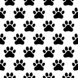 Seamless pattern of print of dogs paws on a white background vector illustration