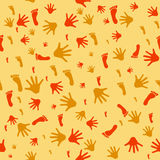 Seamless pattern with prints of hands and feet Royalty Free Stock Photos