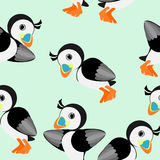 Seamless pattern with puffins. A cute puffin at light-green background stock illustration