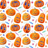 Seamless pattern with pumpkin lanterns, lollipop and candy. Seamless pattern with pumpkin lanterns, lollipop and candy .watercolor hand drawn illustration.white Stock Photography
