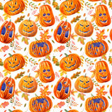 Seamless pattern with pumpkin lanterns, maple leaves, oak and rowan. Seamless pattern with pumpkin lanterns, maple leaves, oak and rowan .watercolor hand drawn Royalty Free Stock Images