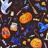 Seamless pattern with pumpkin, lollipop,castle,bat,spider,broom,candle,tree and candy. Royalty Free Stock Photography
