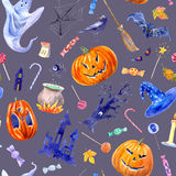 Seamless pattern with pumpkin, lollipop,castle,bat,spider,broom,candle,tree and candy. Stock Photos