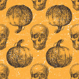 Seamless pattern with pumpkin and skull Stock Images