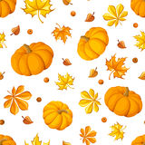 Seamless pattern with pumpkins and autumn leaves. Royalty Free Stock Photo