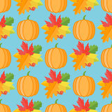 Seamless pattern with pumpkins and autumn leaves on blue background. Vector texture stock illustration
