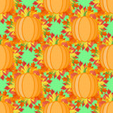 Seamless pattern with pumpkins and autumn leaves. Vector texture Stock Image