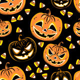 Seamless pattern with a pumpkins and candies. Halloween Party design template. Vector Stock Photography