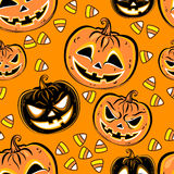 Seamless pattern with a pumpkins and candies. Halloween Party design template. Vector Stock Images