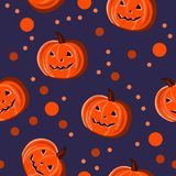 Seamless pattern with pumpkins and dots for Halloween holiday. Royalty Free Stock Images