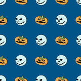 Seamless pattern from pumpkins and ghosts on dark background. Royalty Free Stock Images