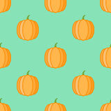 Seamless pattern with pumpkins on green background. Royalty Free Stock Images