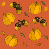 Seamless pattern with pumpkins, leaves and acorns Royalty Free Stock Images