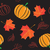 Seamless pattern with pumpkins and leaves. Royalty Free Stock Photo