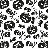 Seamless pattern of pumpkins and skulls Stock Images