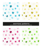 Seamless pattern with puzzle pieces. Four seamless pattern with different color and puzzle pieces Stock Image