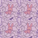 A seamless pattern with a rabbit, and a carrot, and a lavender, on a purple busy background. Nice as wallpaper, or as a fabric, also in vector Royalty Free Stock Photo