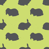 Seamless pattern with rabbit silhouettes. Royalty Free Stock Photo