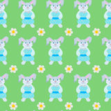 Seamless pattern of rabbits. And flowers Stock Image