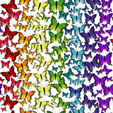 Seamless pattern with rainbow butterflies Stock Images