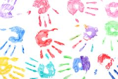 Seamless pattern with rainbow colored kids hand prints on white background Royalty Free Stock Images